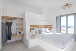 deluxe room oneiro suites bed