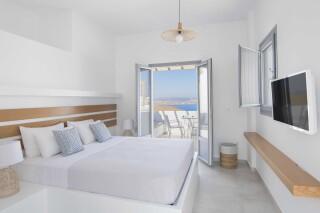 deluxe room oneiro suites bedroom