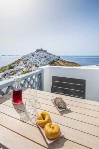 deluxe room oneiro suites breakfast with view